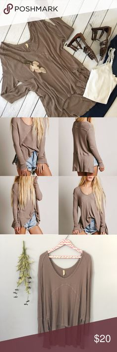 Free People Taupe Thermal So-soft drippy thermal in a yummy textured stretch fabric. Swing silhouette with a subtle hi-low hem and side vents. Stitch detailing along the seams, ribbed neckline. Great condition, only wore a couple times. Fit is generous. Smoke free/pet free. Free People Tops