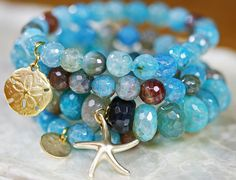 Beautiful aqua colors combined with browns and gold accents. I have three pieces from Laura Hunter that I just love.