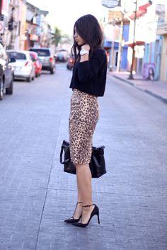 Black long sleeve cropped sweater, leopard pencil skirt, black heels, and black bag