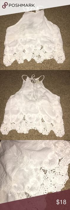 White lace tank top/crop top Cute lace tank top. Can be worn as a crop top or regular. Tops Crop Tops