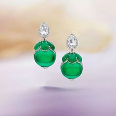 These beautiful flower-like earrings with unusual oval shaped emerald cabochons of over 20 carats ...