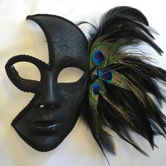 Black 3/4 face Venetian style Mardi Gras Mask with ribbon ties.