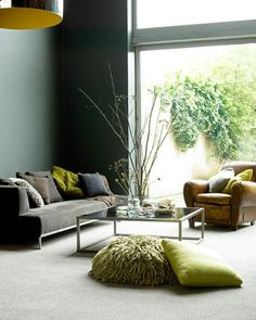 hmm. something about this living room. coffee table? not my style. sofa? not really. yet the sprinkling of green, the pillows up front, on the sofa and leather chair, paired up with that green outside- the staging is fantastic and makes me love this room! (admittedly,  the leather chair in this room is  alright. )