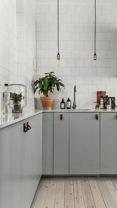 Looking to update your kitchen this year? Find modern inspiration from Sarah @vpsarah to help plan your renovation project. Try using leather pulls on sleek gray cabinets and hanging lights to get a similar look.
