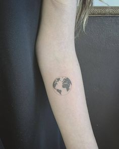 Fine line planet earth tattoo on the left inner forearm. Tattoo...