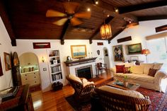Spanish revival - The red oak floors and wood-beamed ceilings are original.