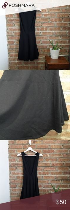 American Apparel. black dress. American Apparel Black  stretchy fabric (60% rayon, 35% nylon, 5% elastance) Size US Medium Flowy skirt and tight at top Back is open and so are sides! Only work once on NYE! Great condition American Apparel Dresses