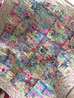 Liberty scrappy log cabins.  A quilt for Evie