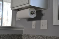 No more traveling paper towel roll! Use command strips to secure it in or under a cabinet!