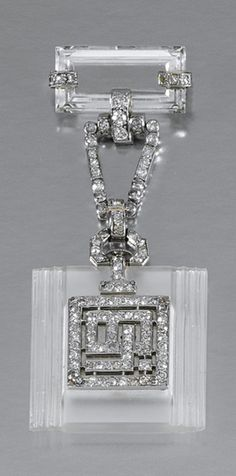 LADY'S ROCK CRYSTAL AND DIAMOND FOB WATCH, 1930S The square shaped plaque of carved rock crystal, decorated to the front with diamond set, interlocking initials depicting the letters 'LB', the reverse with square dial applied with Roman numerals and blued steel hands, suspended from a rock crystal and diamond surmount, set with baguette, circular- and single-cut stones, French assay marks.