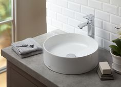 In a simple space, a unique shape of a sink gives the space a unique and personal touch.