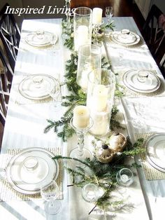 Christmas Tablescape - greens, white candles and silver - beautiful!