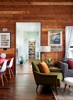 i love the look of the wood walls... the vintage posters... great furniture!