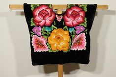 """♥About this huipil Handembroidery top- Ethnic vintage mexican blouse """"huipil de tehuana"""": Frida Kahlo-style- from Istmo de Tehuantepec, Oaxaca, Mexico Desing: hand-embroidery flowers, full embroidery back and front Fabric: BLACK VELVET fabric, cotton lined ✂ --- Huipiles y vestidos"""