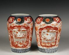 "PAIR OF JAPANESE PORCELAIN VASES - Fine Imari High Shouldered Vases with broad mouths, Guangxu mark (1875-1908), in typical brick red and cobalt blue decoration featuring Phoenix cartouches and lake panels, 10"" x 6 3/4"" diam, fine condition."