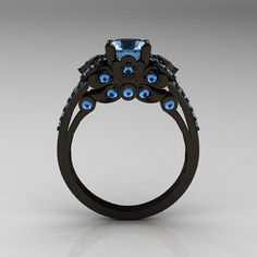 This is relay unique and rare. A black gold ring set with deep blue precious stones
