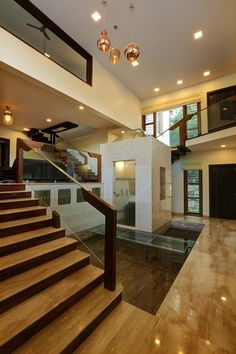 Unni Residence by Alex Jacob, Interior Designer in Bangalore ,Karnataka, India Home Stairs Design, Home Building Design, Bungalow House Design, Home Room Design, Modern House Design, Modern Interior Design, Interior Ideas, Modern House Facades, Ceiling Design Living Room