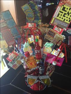 Gift card  bouquet. Super cute way to give gift cards. Add some mini bottles, lottery tickets and other party favors. Makes a great gift!