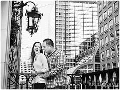 A happy couple laughs together during their urban engagement session with the glass skyscraper buildings of Denver as their backdrop at the University Club in Denver, Colorado. @uclubdenver - April O'Hare Photography http://www.apriloharephotography.com #UniversityClub #UniversityClubDenver #DenverEngagement #WinterinDenver #urbanengagement #urbanphotos #DenverUrbanPhotos