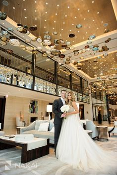 Chicago luxury wedding photo at Langham Hotel lobby - Bride in gown - Groom in tuxedo - High End Fashion wedding picture by Chicago wedding photographer: Nakai Photography http://www.nakaiphotography.com