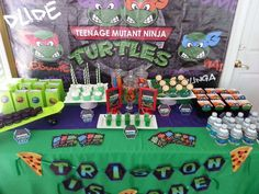 Teenage Mutant Ninja Turtle boy birthday party dessert table and backdrop!  See more party planning ideas at CatchMyParty.com!