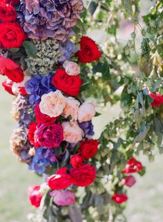 gorgeous florals for wedding arch