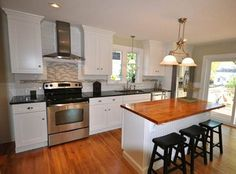 Old Home Remodel - cute but all appliances on one wall. add a island to make it more galley?