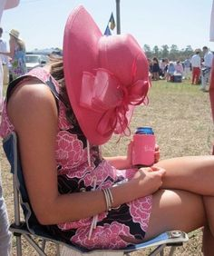 How to identify a southern woman - Even unconscious - beer properly covered with coordinating coozie, hat for sun protection, legs crossed like Mama taught you - perfect :)
