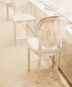 feathered louis chairs. dreamy