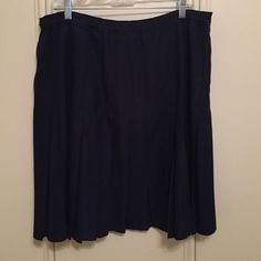 Navy blue pleated skirt Very cute! Knee length. Please keep in mind that colors may vary slightly from actual item due to the lighting or monitor display. Lands' End Skirts