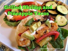 Our first guest post for guest bloggers week has our mouths watering. Grilled shrimp and pineapple tacos with sriracha lime cream! | Fit Bottomed Eats