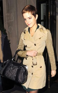 emma in a studded trench coat