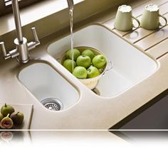 DuPont Corian solid surface countertops with seamless integrated sinks and a built-in drain board