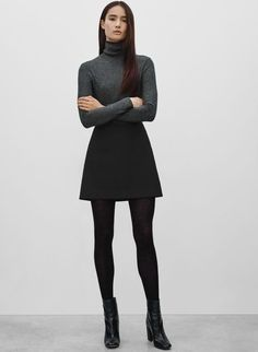 Grey turtle neck, black mini skirt and ankle boots
