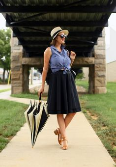 tying the shirt looks really natural here. love the black skirt and chambray top together.