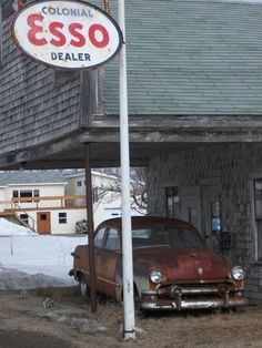 "vintage Ford in waiting - Canadian ""ESSO"" sign  (Standard Oil S.O. for nationalistic foolish Canadians)"