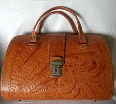 Butterscotch Tooled Leather Vintage Handbag. $58.00, via Etsy.