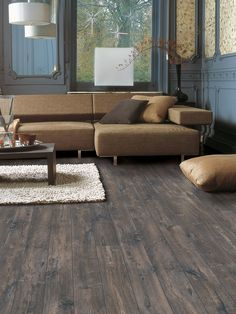 Quick-Step Laminate Flooring -  Perspective Wide 'Caribbean oak dark' (ULW1546) in a classic living room. To find more living room inspiration, visit our website: https://www.quick-step.co.uk/en-gb/room-types/choose-the-perfect-living-room-flooring #salon #woonkamer Laminate Flooring Colors, Vinyl Flooring, Parquet Sol, Parquet Flooring, Floors, Lakeside Cottage, Flooring Store, Commercial Flooring, Floor Colors