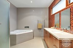 Red and orange feature tile wall.  Bathroom ideas.  Photography by CT Creative.