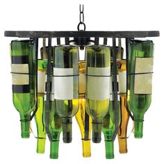 This pendant lamp is completed by adding your own recycled wine bottles #product_design #DIY #upcycled