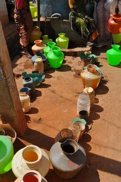 Water vessels hold people's places in line for the taps.