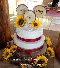 Burgundy and white buttercream wedding cake with sunflowers, burlap and ribbon. Western, fall, rustic. www.thecakemaker.us
