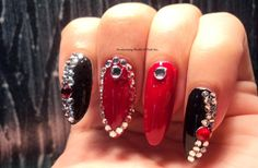 Mesmerizing World Of Nail Art..: Red and Black Bling Stiletto Nails http://anubhootikhanna.blogspot.in/2014/12/red-and-black-bling-stiletto-nails.html#more