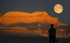 Full moon hike at Bryce! Aug 31 or sept 1. Need someone to stay with the kids. First 60 people at 7:00 in the morning get tickets for that night. (Full Moon over Powell Point in background with Park Ranger Kevin Poe in silhouette)