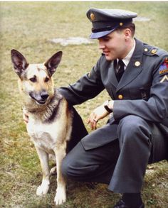 elvis presley and a handsome dog.