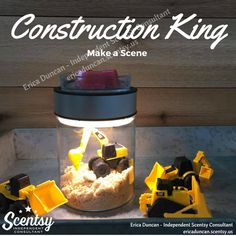 My little construction addict LOVES this scene!  We used brown sugar for the 'sand' and placed a few inexpensive toys.  Easy peasy!