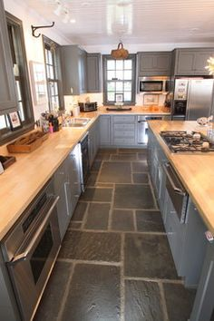 Grey kitchen cabinets with butcher block countertops will enhance your kitchen cabinets. Decorate your kitchen as possible to get a feel of comfort for cooking. May this grey kitchen cabinets wit Kitchen Tile Interior, Eclectic Kitchen, Kitchen Decor, Kitchen Ideas, Kitchen Photos, Kitchen Designs, Kitchen Layout, Kitchen Colors, Kitchen Inspiration