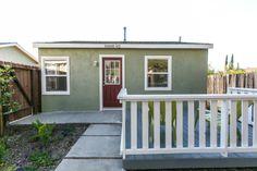 Nassau duplex home with green paint, burgundy door & deck. #Duplex #RealEstate #HouseFlipping #California #Craftsman  www.verono.com/nassau