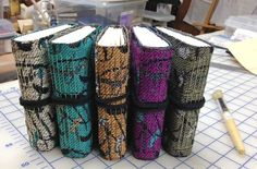 My newest blank journals. Covers were designed on iPad, processed in Photoshop, handwoven on TC-1 (jacquard) loom, fabrics reinforced with acrylic medium, and books sewn in long stitch. More info about my work on www.weaverly.typepad.com.