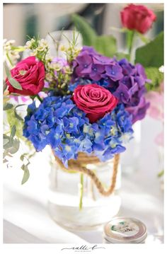 Bright reception flowers including hydrangea and roses